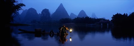 Fisherman fishing at night, Li River , China by Panoramic Images art print
