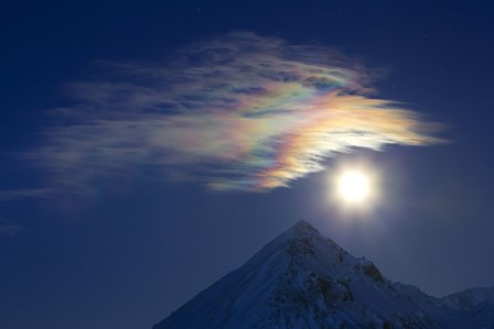 Full Moon with Rainbow Clouds at Ogilvie Mountains by Joseph Bradley/Stocktrek Images art print