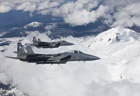 Two F-15 Eagles Fly Past Snow Capped Peaks in Central Oregon by HIGH-G Productions/Stocktrek Images art print
