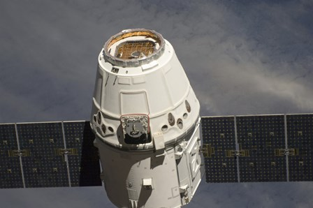 The SpaceX Dragon Commercial Cargo Craft by Stocktrek Images art print