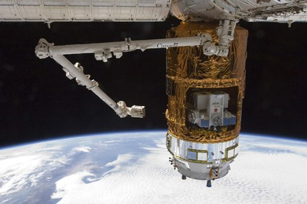 The Japanese H-II Transfer Vehicle in the Grasp of Canadarm2 by Stocktrek Images art print