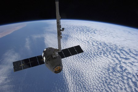 The SpaceX Dragon Cargo Craft Prior to being Released from the Canadarm2 by Stocktrek Images art print
