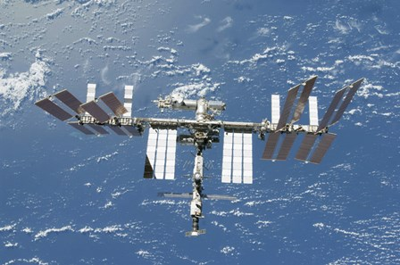 International Space Station Backdropped by a Blue and White Part of Earth by Stocktrek Images art print