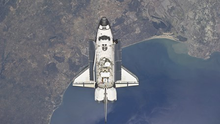The Space Shuttle Atlanti Flying Above the Atlantic coast of Spain and the Gulf of Cadiz by Stocktrek Images art print