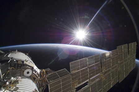 The International Space Station Backdropped by the Bright Sun over Earth's Horizon by Stocktrek Images art print