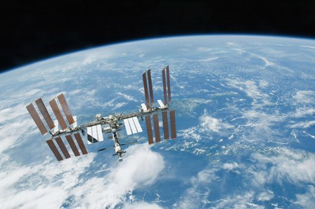 The International Space Station backdropped by Earth's Horizon by Stocktrek Images art print