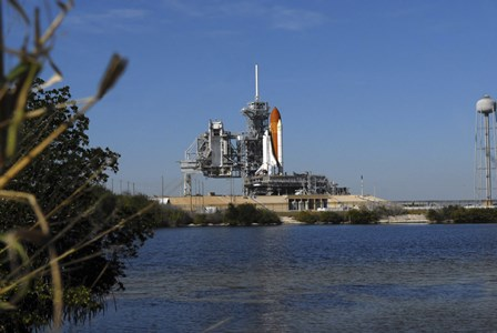 Space Shuttle Discovery on the Launch Pad by Stocktrek Images art print