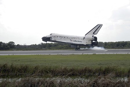 Space Shuttle Discovery Touches Down on the Runway at Kennedy Space Center by Stocktrek Images art print