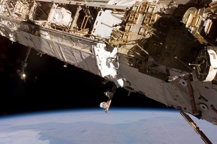 Astronaut Participates in Extravehicular Activity on the International Space Station by Stocktrek Images art print