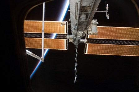 The International Space Station Backdropped by the Airglow Above Earth's Horizon by Stocktrek Images art print