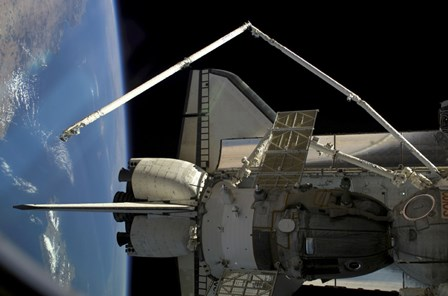 A Soyuz Vehicle and the Space Shuttle Discovery Docked to the International Space Station by Stocktrek Images art print