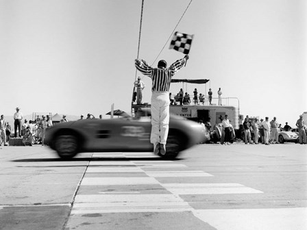Man Jumping Waving Checkered Flag by H. Armstrong Roberts art print
