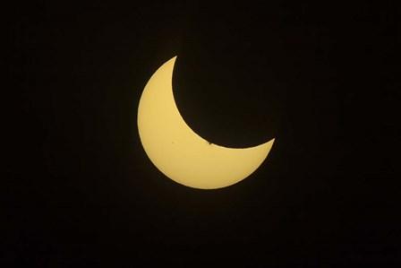 Partial Eclipse of the Sun as seen from Jasper, Alberta, Canada by Alan Dyer/Stocktrek Images art print
