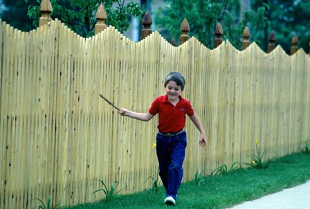 1980s Smiling Boy Running Along Sidewalk by Vintage PI art print